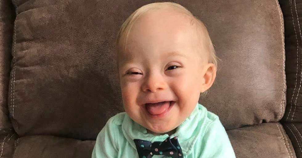 niño con síndrome de down - persona con discapacidad