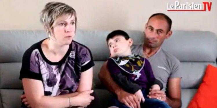 Nolan con sus padres