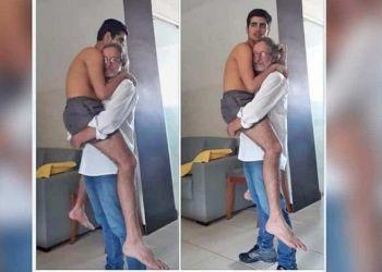 Padre coge en brazos a su hijo con autismo