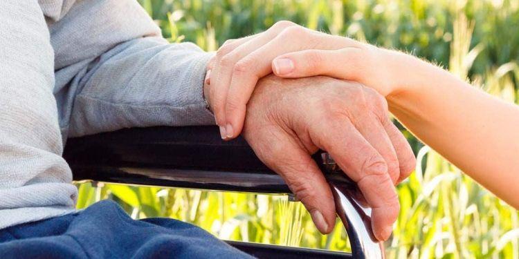 Persona en silla de ruedas con incapacidad permanente total